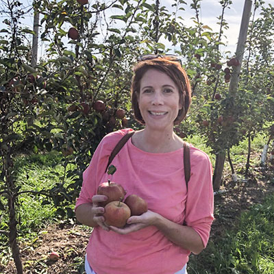 Lori Perez, Psychology chair, in an apple orchard