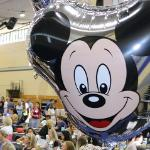 Mickey balloon with workshop attendees in the background - thumbnail.