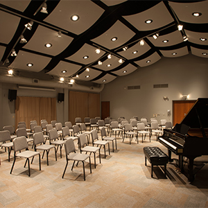 CADE Rehearsal space with chairs and piano