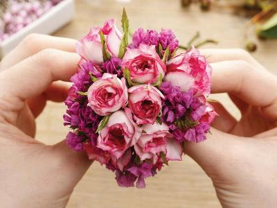 Hands creating bouquet