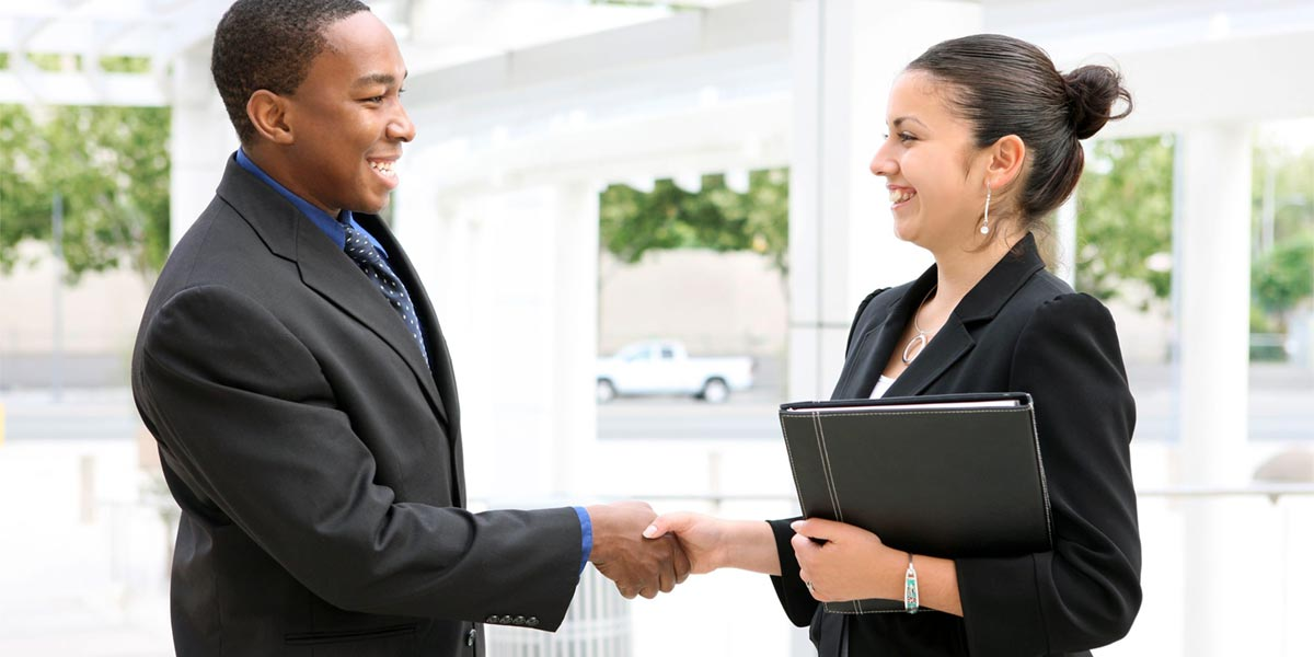 Student employee shaking hands with employer.