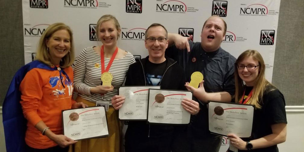 Members of the Strategic Communications team with their awards.