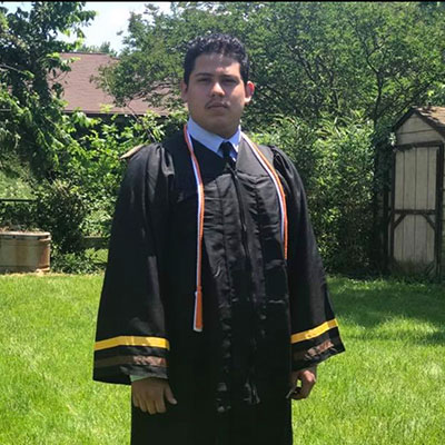 AACC Student, Kevin Lemus, in his graduation robes.
