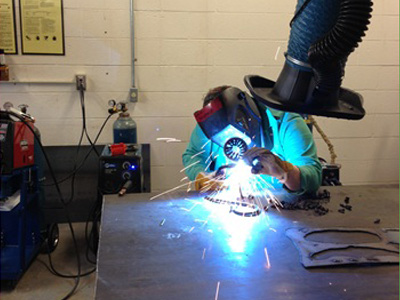 AACC art students work with metal.