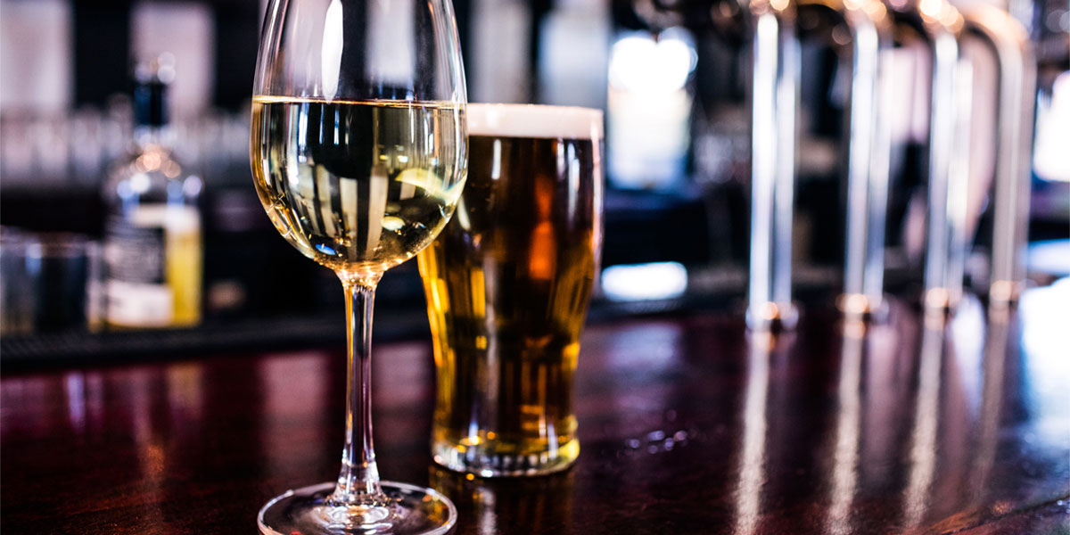 wine and beer glasses in restaurant setting