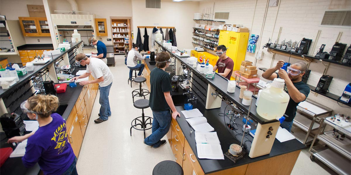 Students conduct experiments in a science lab