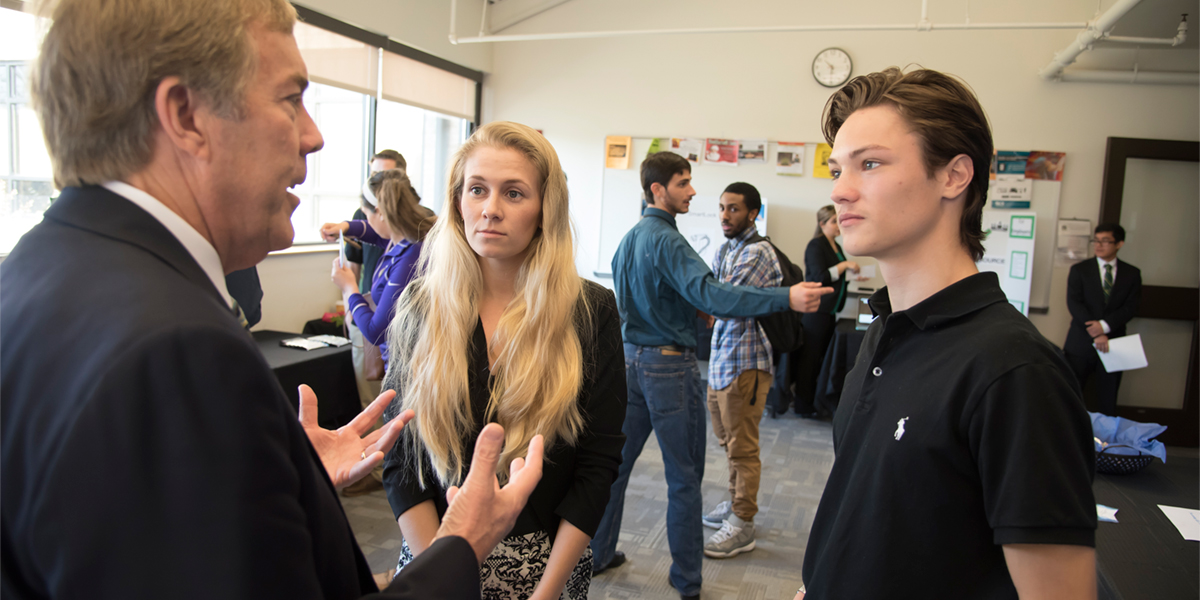 business students in a discussion at business law event