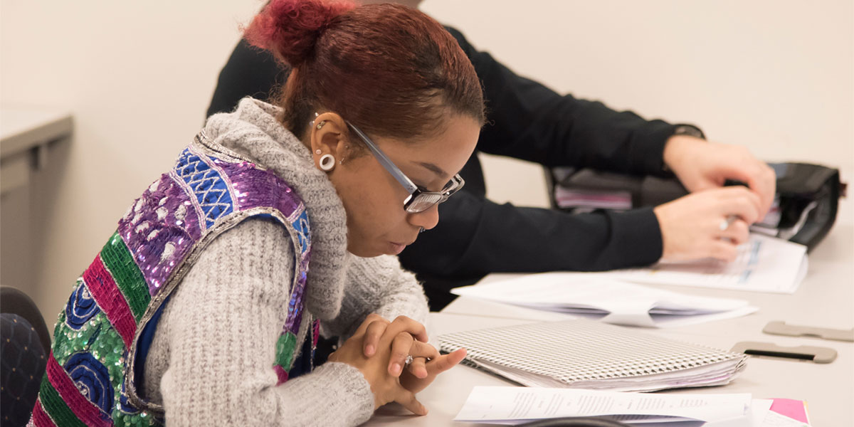 AACC student studies at her desk.