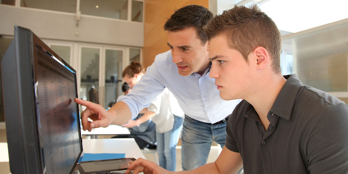 Instructor and student using a computer.