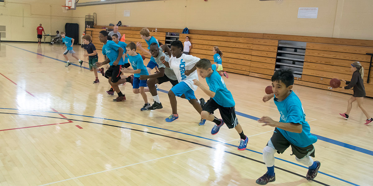 Image of kids running in the gym
