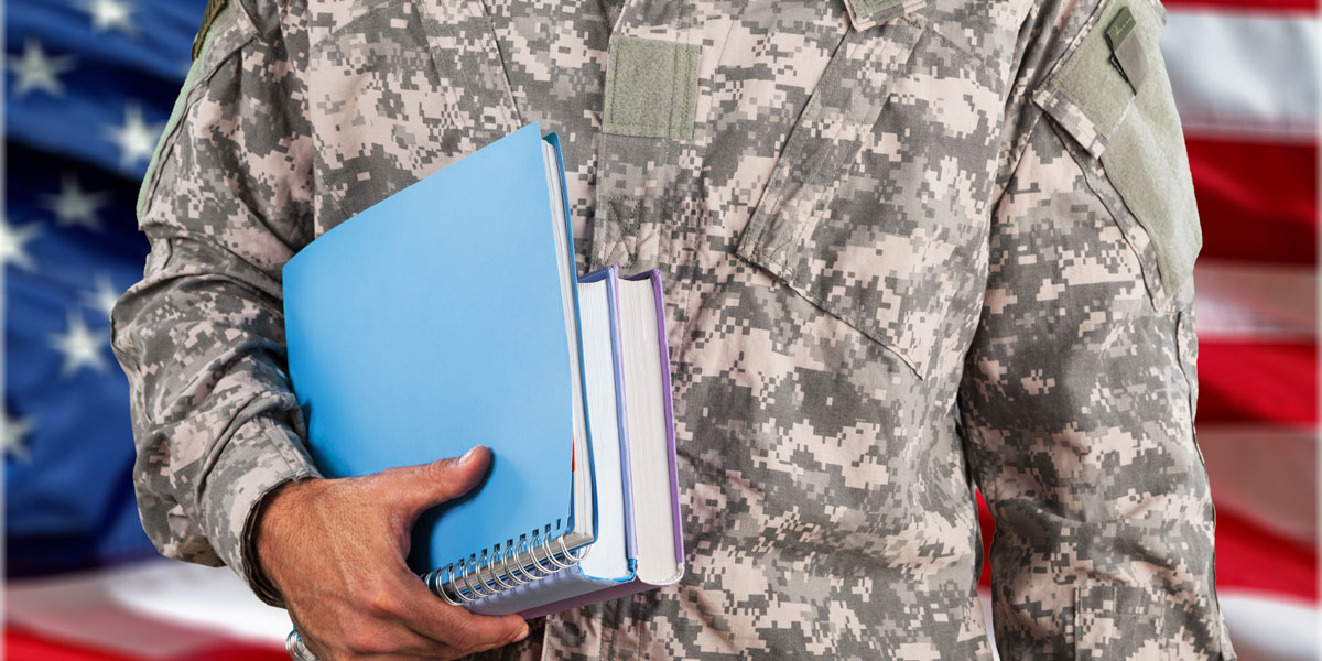 Military man in uniform with books.