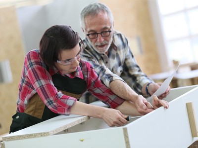 adult students in woodworking class